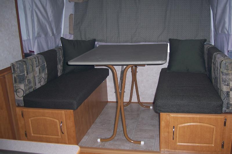 When not in use the heater, legs, and LPG hose are stored under one of the dinette seats