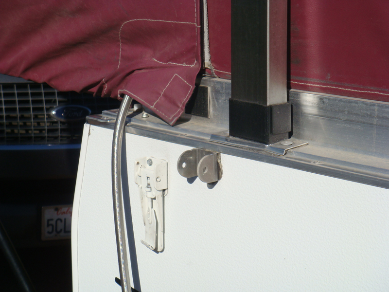 Running the braided steel LPG hose to the inside of the camper.