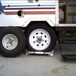 Finished. Old tire (left) as a comparison. BAL single wheel chock keeps trailer wheel secure.
