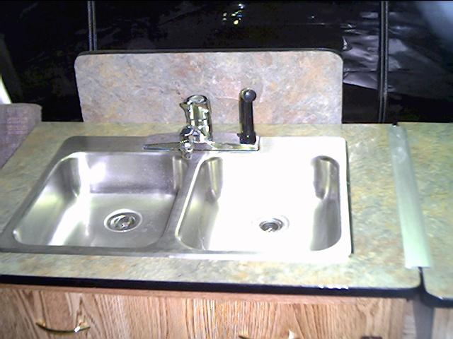 During transport the sink folds over the the back splash sits of the floor to keep the unit level.