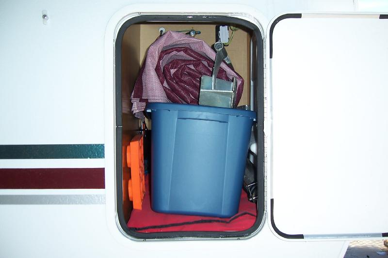 Everything we need to set up the camper is stored in this compartment with outside access.