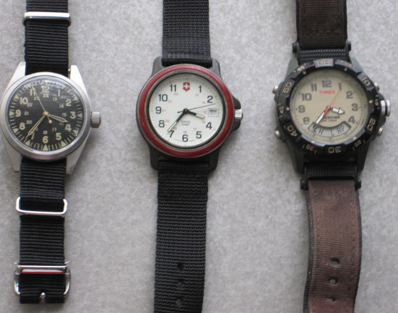 (L-R) Military, Swiss Army brand, Timex. (The bands on the Military and Swiss Army watches are not the originals).
