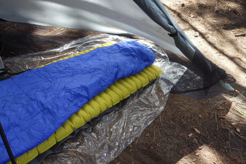 Gossamer Gear Polycro ground sheet is perfect for this shelter.  Note the door tie at the right of the picture when you want the door open. I usually leave it open unless bugs are a problem. Properly oriented, the shelter will keep you dry with the door open.