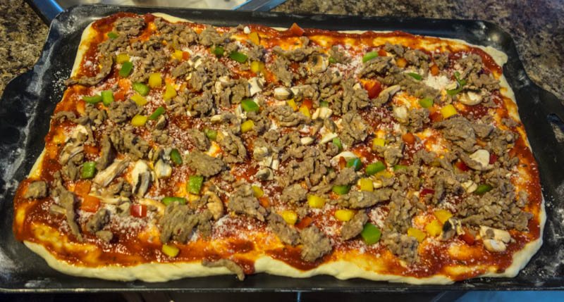 You remembered to cook and prepare some Italian Sausage a head of time. Now is the time to add it to the pizza.
