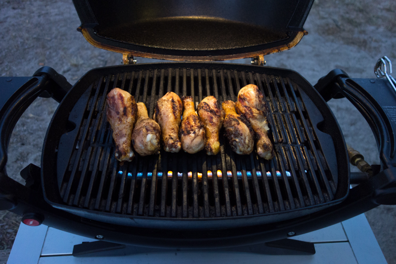 Grilling chicken at dusk