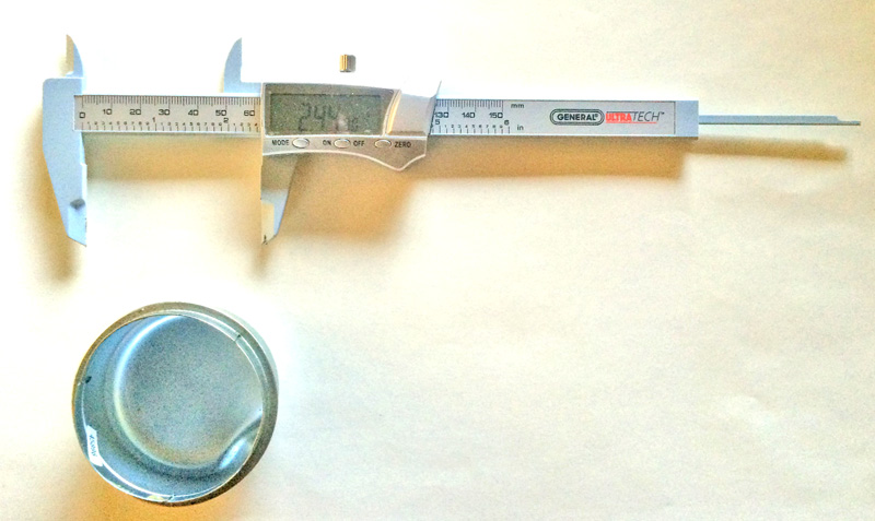 measuring prepared cap with a caliper
