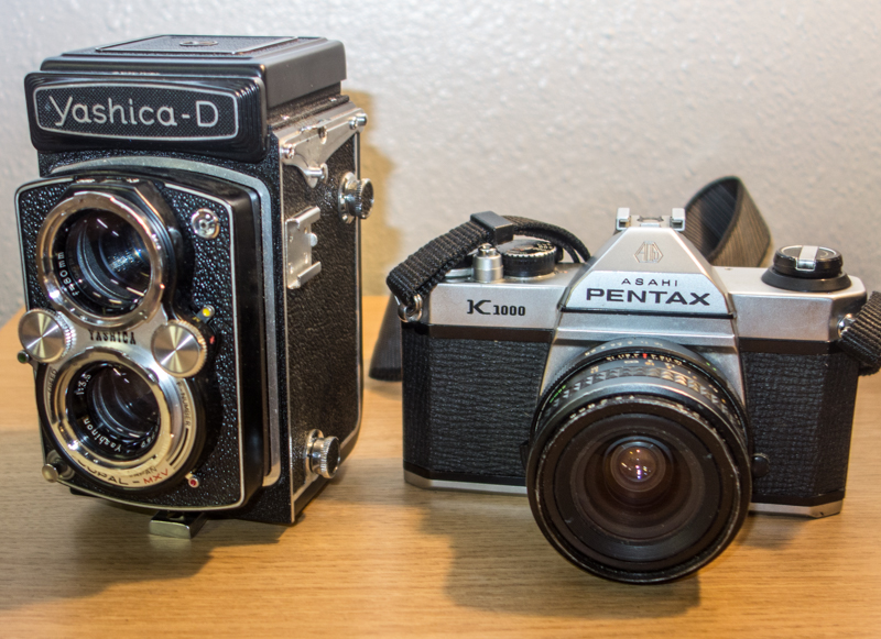 Left is a Yashica Twin Lens Reflex camera and right is a Pentax K100 35mm Single Lens Reflex. Both use film.