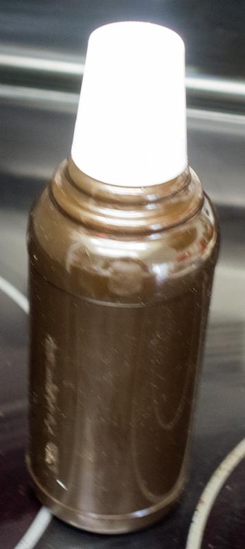 Re-purposed P.E.T.E. heavy duty fuel bottle originally contained prescription mouth wash.